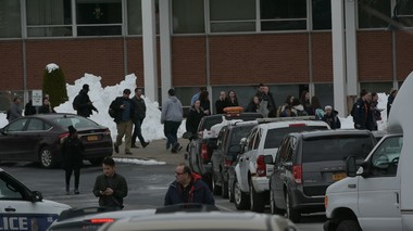 Students leave the Utica College student center after a multi-hour lockdown on Monday morning. Hundreds of students were escorted to the center with their hands up by police after spending several hours in dark, barricaded classrooms.