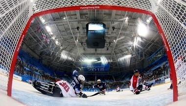 GANGNEUNG, SOUTH KOREA - MARCH 11: Luke McDermott #13 of United States fails to score over Kazuya Mochizuki, goaltender of Japan in the Ice Hockey Preliminary Round - Group B game between United States and Japan during day two of the PyeongChang 2018 Paralympic Games on March 11, 2018 in Gangneung, South Korea.