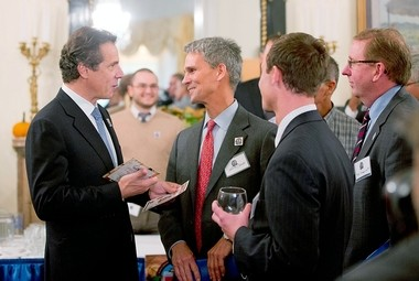 """New York Gov. Andrew Cuomo, left, talks to visitors to the Executive Mansion as part of a """"Wine, Beer and Spirits Summit"""" on Wednesday, Oct. 24, 2012, in Albany."""
