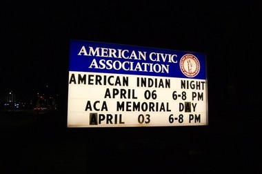 The sign outside the Binghamton American Civic Association announces ongoing programs as well as last week's vigil.