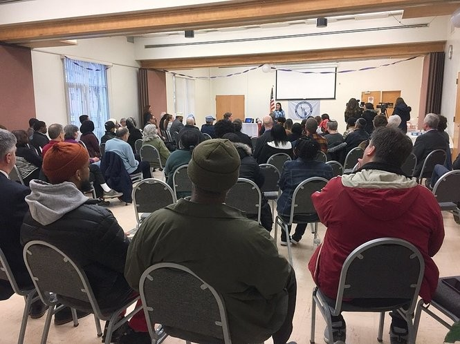 The vigil at the Binghamton American Civic Association was filled with victim's families as well as community members.