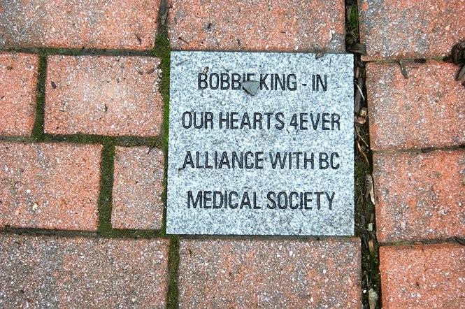 """A memorial stone in honor of victim Roberta """"Bobbie"""" King."""