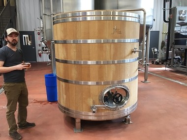 Brewer and co-owner Matt Whalen holds a golden sour ale fermented and aged in this 20-barrel foeder at Good Nature Brewing Co. in Hamilton.