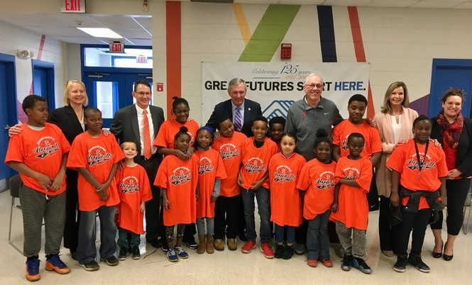 Onondaga County Executive Joanie Mahoney, Boys and Girls Club board chair Tim McDevitt, Congressman John Katko, Jim and Juli Boeheim, and Syracuse deputy parks commissioner Julie LaFave pose with kids at the East Fayette Street Boys and Girls Club. April 27, 2018