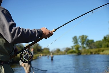 An angler uses a Douglas Outdoors rod on the Salmon River in Pulaski. The company's rods sell for $160 to about $695 and are available at more than 100 dealers, including Cabela's.