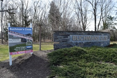 A sign outside Buchmans Close, near Lyndon Corners in the town of Manlius, advertises a 37.5 percent tax break because the homes are classified as condominiums.