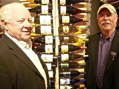 John Martini, left, owner of Anthony Road Wine Co. and Scott Osborn, owner of Fox Run Vineyards, attend the opening of a wine shop in Luxembourg in 2014. The two Finger Lakes wineries are part of an effort to sell more New York wines in Europe.
