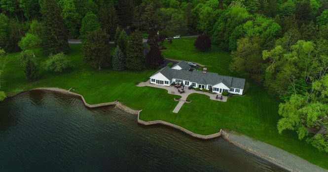 Billionaire Tom Golisano moved to Florida, but still owns this $5.7-million house on Canandaigua Lake. He asked the town to cut the assessment in half because geese are pooping on the lawn.