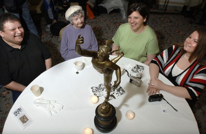 Descendants of 1907 Boston Marathon winner, Native Canadian, Tom Longboat, from left, grandson Brian Winnie, daughter Phillis Winnie, and great-granddaughters Michele DiGiacomo, and Jessica Hazard, all of Buffalo, N.Y., sit with Longboat's trophy during an awards ceremony in Boston, Saturday, April 14, 2007.