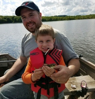 Hunter Grant, 4, of Cato, caught his first perch on a hook and minnow on Parker's Pond. His father, Ryan Grant, is also pictured.