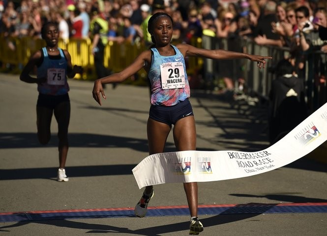 Mary Wacera of Kenya finishes first in the women's division in the 2017 Boilermaker in Utica July 9, 2017.