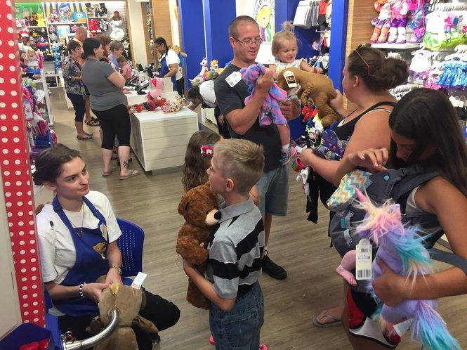 Customers are pictured inside Build-A-Bear Workshop at Destiny USA in Syracuse for the store's first-ever 'Pay Your Age Day' Thursday, July 12, 2018.