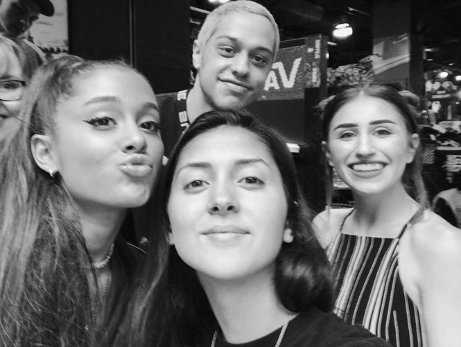 """Saturday Night Live"" star Pete Davidson, top, and his fiancee, singer Ariana Grande, left, pose with fans in the Zumiez store at Destiny USA on Tuesday, July 17, 2018. Davidson is in Syracuse to film a new movie."