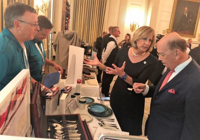 U.S. Commerce Secretary Wilbur Ross holds an American-made spoon from Sherrill Manufacturing in Oneida County, New York, on Tuesday, July 23, 2018 at the White House. Rep. Claudia Tenney, explained to Ross that the White House uses Chinese-made spoons from Oneida Ltd.