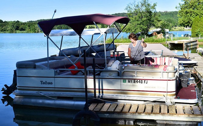 Sherry Whipple gets her pontoon boat ready for an afternoon out fishing on the Jamesville Reservoir.