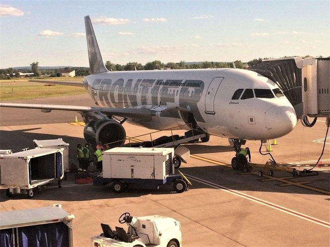 Ground crews load luggage onto a Frontier Airlines plane at Syracuse Hancock International Airport on July 7.