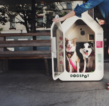 In this promotional photo, a dog owner displays use of a DogSpot temporary dog house. They are now available at 10 New York State Thruway service centers.