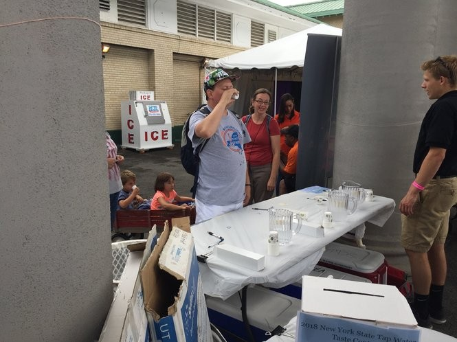 A taster tests the tap water at the New York State Fair's annual best water contest.