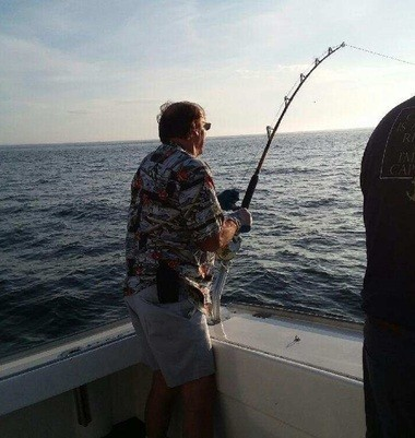 Lombardo takes his turn at reeling in the fish.