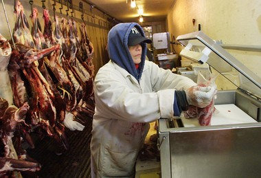 In this 2003 photo, Laurie Nolan, of Tim Delaney's Deer Processing in Fleming, NY, packages venison for the Central New York Food Bank as part of the Venison Donation Coalition program.
