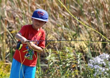 A youngster practices his fly fishing technique during Honeywell Sportsmen's Days.
