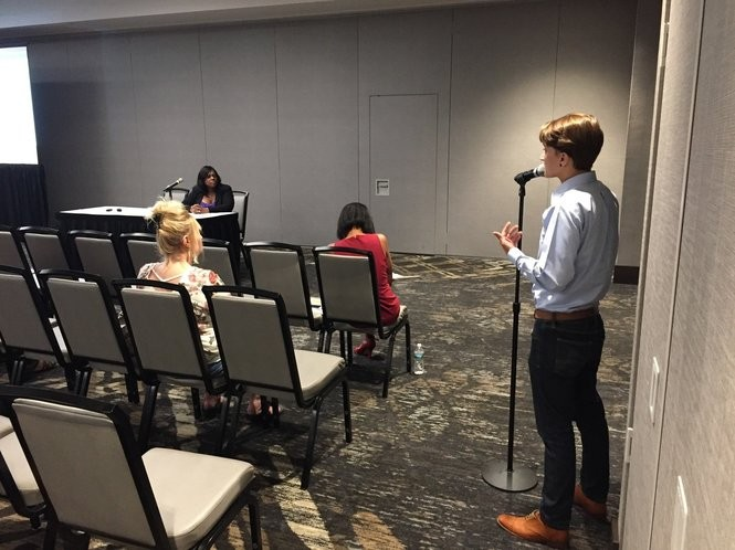 Sarah Stenuf of Auburn, right, speaks on behalf of legalizing marijuana at a state hearing Tuesday on the issue at a hotel in East Syracuse.