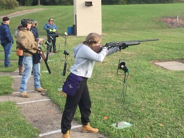 Sadie Schumacher, 14, a member of the Midlakes High School team, takes aim.