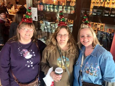 Shoppers traveled 90 minutes to bargain hunt and people watch at Destiny USA. Elaine Bordenet, (from left to right) Lori Johnston and Sheri Saddlemire wore Christmas tree hats to honor a relative and fellow shopper who passed away earlier this year.