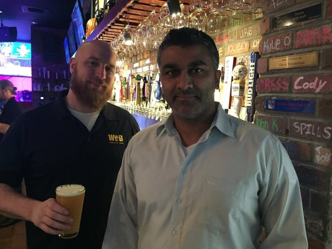 Manager Cody Van Auken and franchise owner Neil Patel at the World of Beer bar and restaurant at Destiny USA in Syracuse.