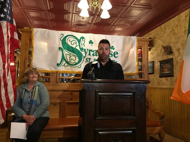 Casey Vanderstouw accepts his naming as 2019 Gael of the Year, given for community service, by the Syracuse St. Patrick's Parade committee. He is the band director for the Baldwinsville schools. To the left is parade committee president Janet Higgins.