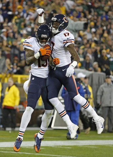 Chicago Bears wide receiver Brandon Marshall (15) and wide receiver Alshon Jeffery (17) celebrate scoring a touchdown against the Green Bay Packers during an NFL football game Monday, Nov. 4, 2013, in Green Bay, Wis. (AP Photo/Matt Ludtke)