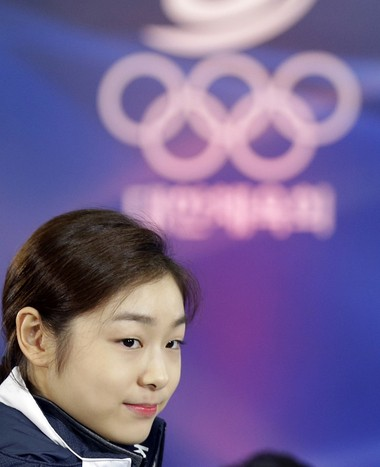 South Korean Kim Yuna, Vancouver gold medalist for the women's figure skating, attends the inaugural ceremony of the South Korean team for the Sochi Winter Olympics in Seoul, South Korea, Thursday, Jan. 23, 2014. (AP Photo/Lee Jin-man)