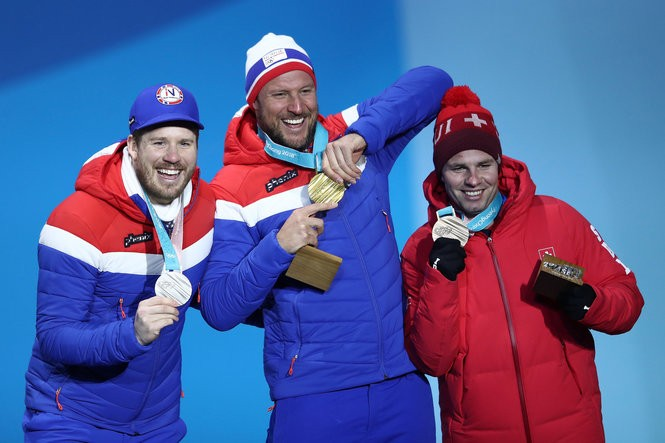 Silver medalist Kjetil Jansrud of Norway, gold medalist Aksel Lund Svindal of Norway and bronze medalist Beat Feuz of Switzerland celebrate during the medal ceremony for Alpine Skiing - Men's Downhill at the PyeongChang 2018 Winter Olympic Games on Feb. 15, 2018. (Clive Mason/Getty Images)