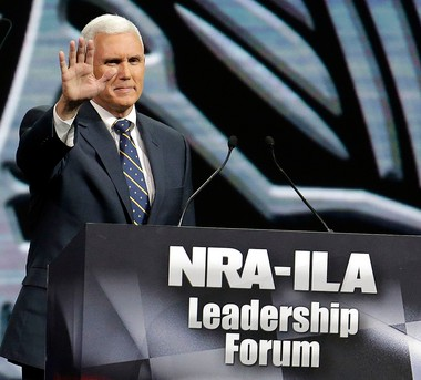 Gov. Mike Pence waves after speaking at the leadership forum at the National Rifle Association's annual convention. (AP Photo/AJ Mast)