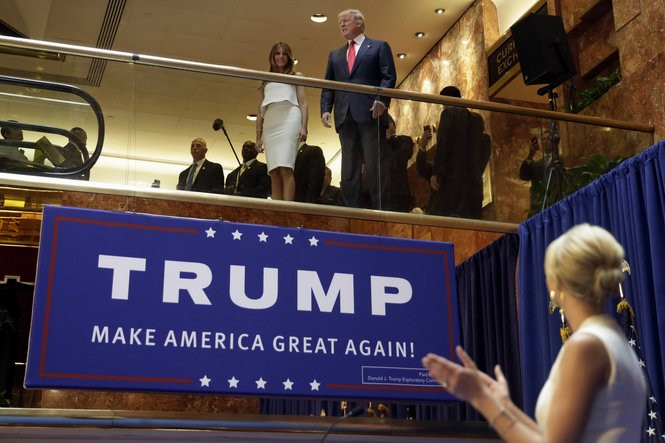 FILE - In this June 16, 2015, file photo, Donald Trump, accompanied by his wife Melania Trump, is applauded by his daughter Ivanka Trump, right as he's introduced before his announcement that he will run for president in the lobby of Trump Tower in New York.