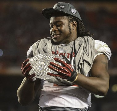 Alabama running back Eddie Lacy admires the crystal football after beating Notre Dame and earning the offensive MVP award. (Vasha Hunt/al.com)