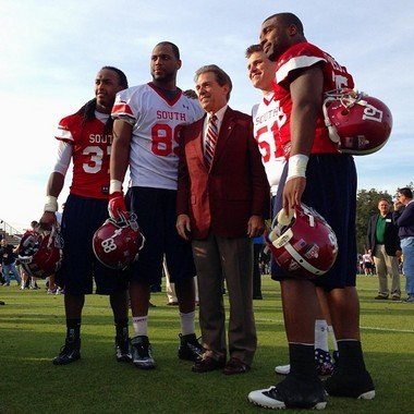 Robert Lester, Michael Williams, Carson Tinker and Nico Johnson pose for a picture with Alabama coach Nick Saban after Senior Bowl practice Monday. (Izzy Gould/igould@al.com)