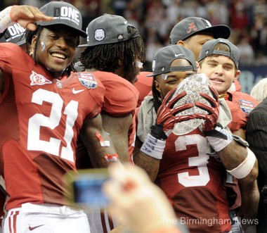 Alabama defensive back Dre Kirkpatrick (21) celebrates as Alabama running back Trent Richardson (3) kisses the trophy after the BCS Championship Game at the Mercedes-Benz Superdome in New Orleans, Monday, Jan. 9, 2012. (The Birmingham News/Mark Almond)