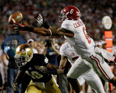 Alabama's Ha'Sean Clinton-Dix (6) intercepts a pass over Notre Dame's DaVaris Daniels (10) during the second half of the BCS National Championship college football game Monday, Jan. 7, 2013, in Miami. (AP Photo/David J. Phillip)