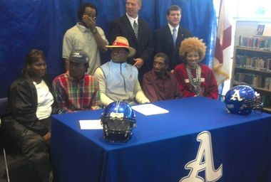 Reuben Foster, dressed like Nick Saban, signed with his family and coaches at Auburn High's ceremony. (Joel A. Erickson/AL.com)