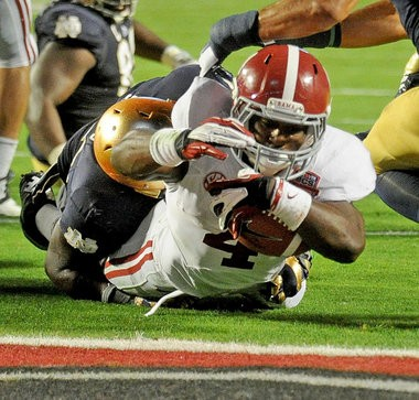 Alabama running back T.J. Yeldon (4) stretches for yardage during the first half of the Discover BCS National Championship game Jan. 7, 2013, at Sun Life Stadium in Miami Gardens, Fla. (Julie Bennett / jbennett@al.com)
