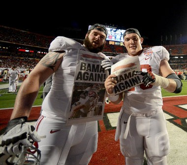 Alabama offensive lineman Austin Shepherd (79) and Alabama offensive lineman Ryan Kelly (70) celebrate celebrates the Tide's victory in the Discover BCS National Championship game Jan. 7, 2013, at Sun Life Stadium in Miami Gardens, Fla. (Julie Bennett / jbennett@al.com)