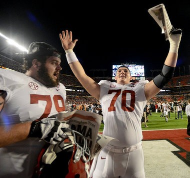Alabama offensive lineman Austin Shepherd (79) and Alabama offensive lineman Ryan Kelly (70) celebrate the Tide's victory in the Discover BCS National Championship game Jan. 7, 2013, at Sun Life Stadium in Miami Gardens, Fla. (Julie Bennett / jbennett@al.com)