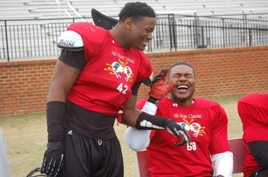Muscle Shoals' defensive lineman Dee Liner laughs while joking with Reuben Foster, left, during a break at Alabama All-Stars practice in December (2012) at Huntingdon College in Montgomery. (Josh Bean/jbean@al.com)