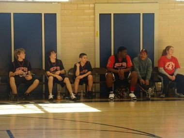 A'Shawn Robinson (right) takes a break in a middle school basketball game.