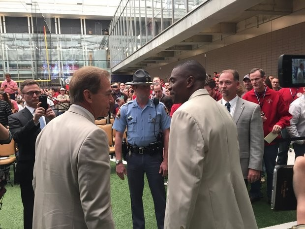 Kerry Goode (right) speaks with Nick Saban in Atlanta on May 6, 2016.