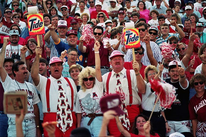 "Alabama super fans, Jerry Bogle and Troy Ferguson, AKA ""The Roll Tide Guys"" are shown during the 1992 Vanderbilt game. (Photo courtesy of the Paul W. Bryant Museum)"