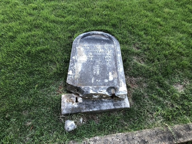 A broken headstone at Evergreen Cemetery in Tuscaloosa.