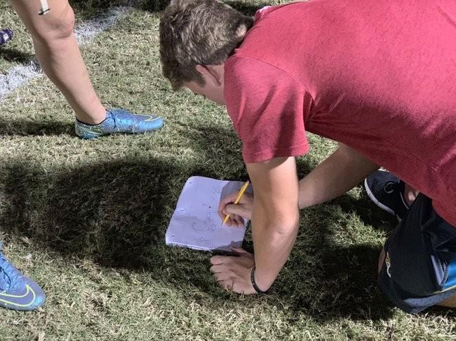 Mac Jones schemes a new play for the ZTA flag football team.