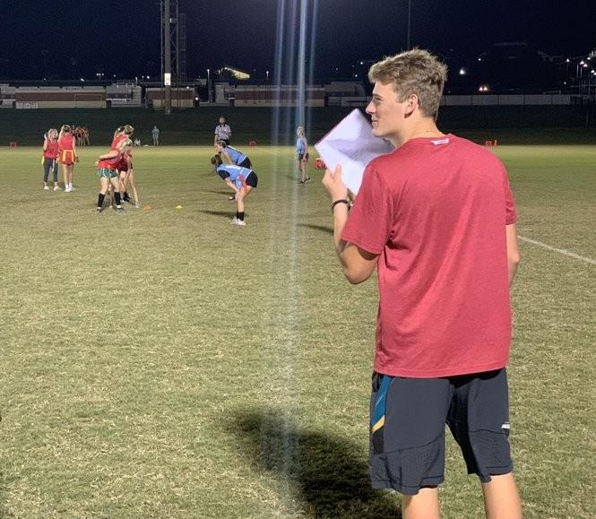 Mac Jones shields his mouth sharing strategy as the ZTA flag football coach.